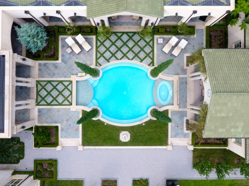 Aerial of the pool area shows inlaid Diamond Zoysia within the flagstone patio which we maintain using a hedge trimmer.