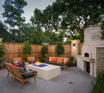 Fire pit and custom fireplace with pizza oven offer a unique space for entertaining and spending quality time with family.
